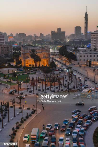tahrir square in cairo at sunset - north africa stock pictures, royalty-free photos & images