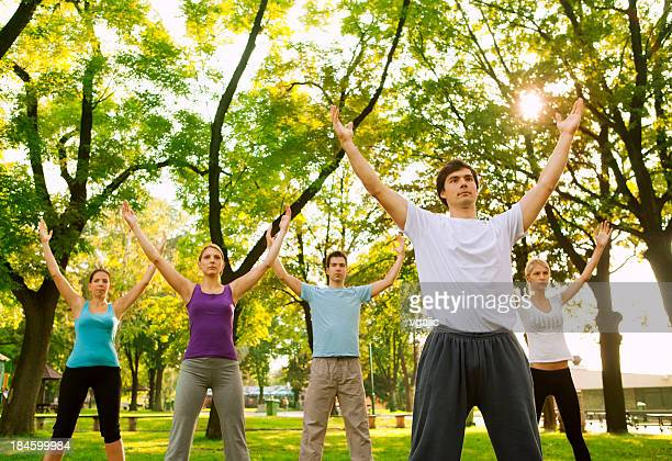 Tai Chi: Group of Young People Practicing Outdoor