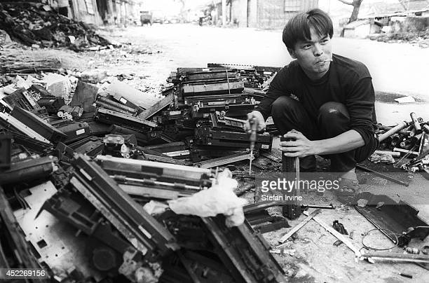 Tai Chunhua extracts toners from the old printer cartridges Many labourers suffer from allergies after working with the toner for a long time he says...