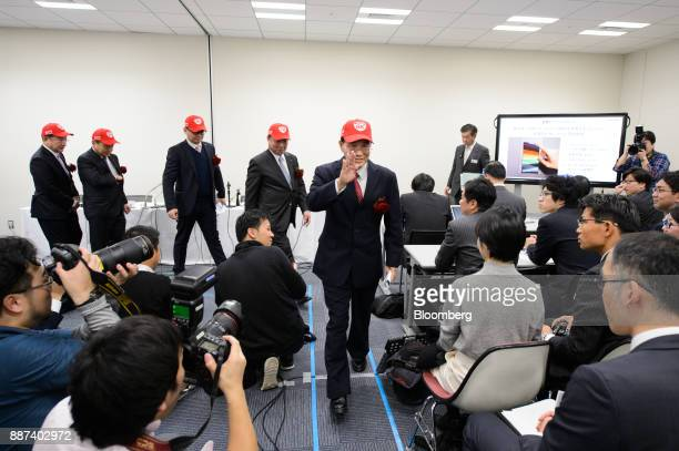 Tai Jeng Wu president and chief executive officer of Sharp Corp center and other executives leave a news conference in Tokyo Japan on Thursday Dec 7...