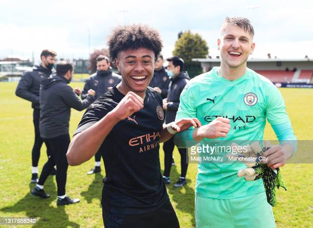 Tai Sodje and Mikki Van Sas of Manchester City celebrate after winning the Under 18's Premier League North title during the Under 18's Premier League...