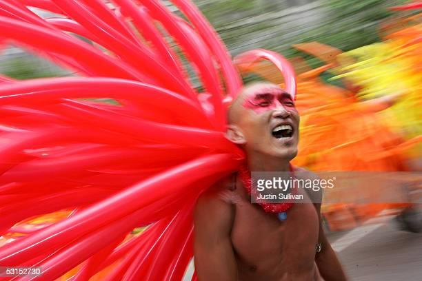 Tai Trang wears balloons on his back as he dances during the 2005 San Francisco Pride Parade June 26, 2005 in San Francisco, California. Tens of...