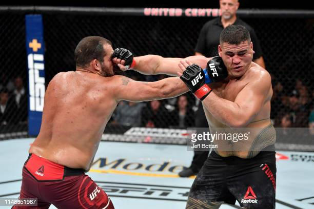 Tai Tuivasa of Australia and Blagoy Ivanov of Bulgaria exchange punches in their heavyweight bout during the UFC 238 event at the United Center on...