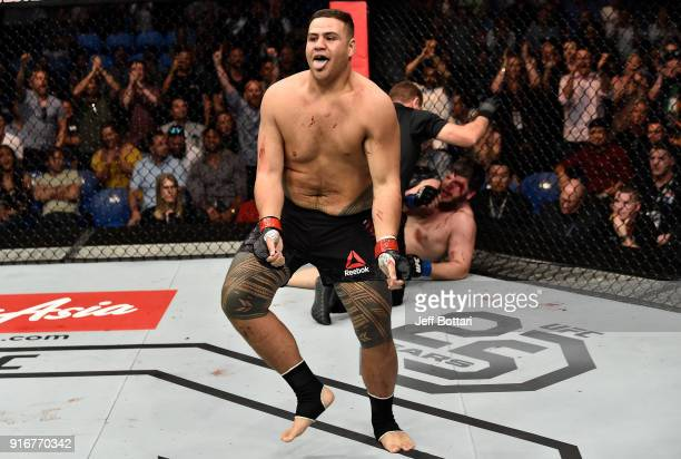Tai Tuivasa of Australia celebrates his victory over Cyril Asker of France in their heavyweight bout during the UFC 221 event at Perth Arena on...