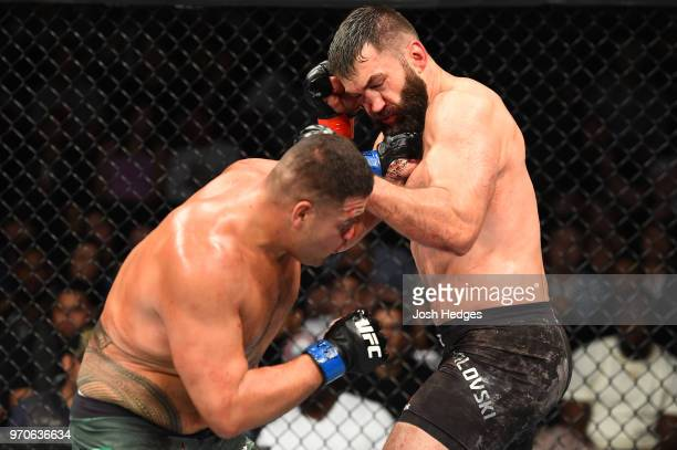 Tai Tuivasa of Australia punches Andrei Arlovski of Belarus in their heavyweight fight during the UFC 225 event at the United Center on June 9 2018...