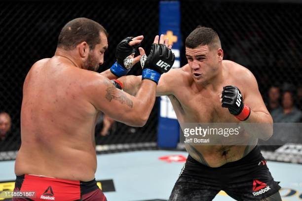 Tai Tuivasa of Australia punches Blagoy Ivanov of Bulgaria in their heavyweight bout during the UFC 238 event at the United Center on June 8 2019 in...