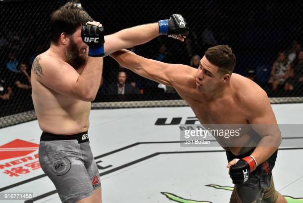 Tai Tuivasa of Australia punches Cyril Asker of France in their heavyweight bout during the UFC 221 event at Perth Arena on February 11 2018 in Perth...