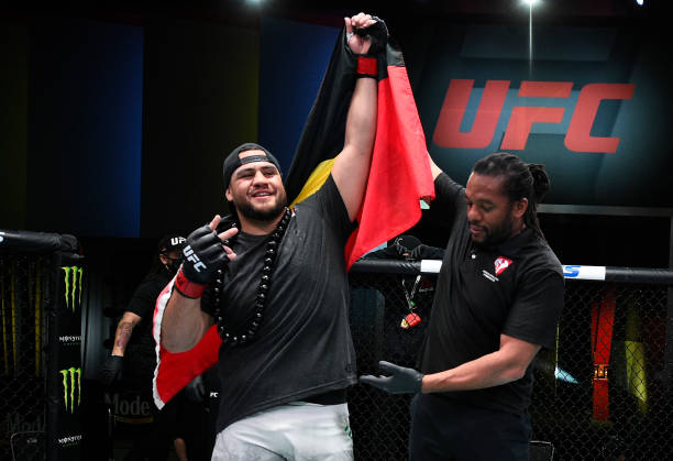Tai Tuivasa of Australia reacts after his victory over Harry Hunsucker in their heavyweight fight during the UFC Fight Night event at UFC APEX on...