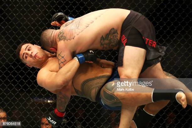 Tai Tuivasa of Australia takes down Rashad Coulter of the USA in their heavyweight bout during the UFC Fight Night at Qudos Bank Arena on November 19...