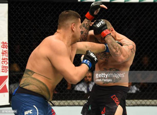 Tai Tuivasa punches Rashad Coulter in their heavyweight bout during the UFC Fight Night event inside the Qudos Bank Arena on November 19 2017 in...