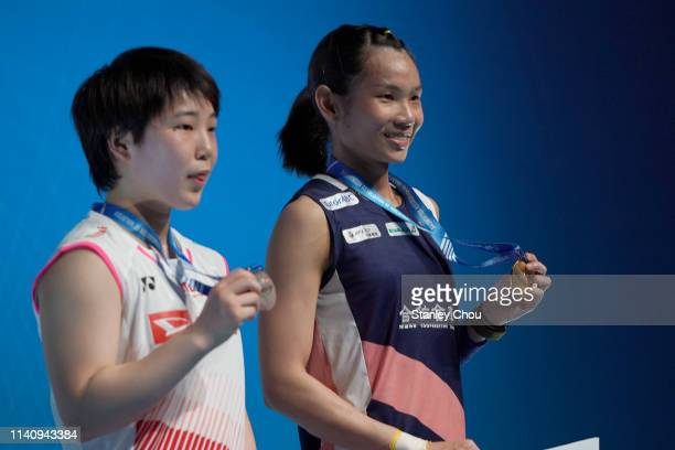 Tai Tzu Ying of Chinese Taipei and Akane Yamakuchi of Japan shows off their medals during the presentation ceremony on day six of the Badminton...