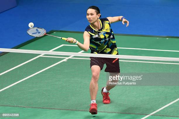 Tai Tzu Ying of Chinese Taipei competes against Minatsu Mitani of Japan during Womens Single Round 1 match of the BCA Indonesia Open 2017 at Plenary...