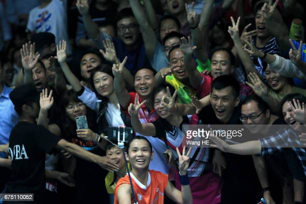 Tai Tzu Ying of Chinese Taipei poses for pictures with fans after winning women's singles final match against Akane Yamaguchi of Japan at the 2017...