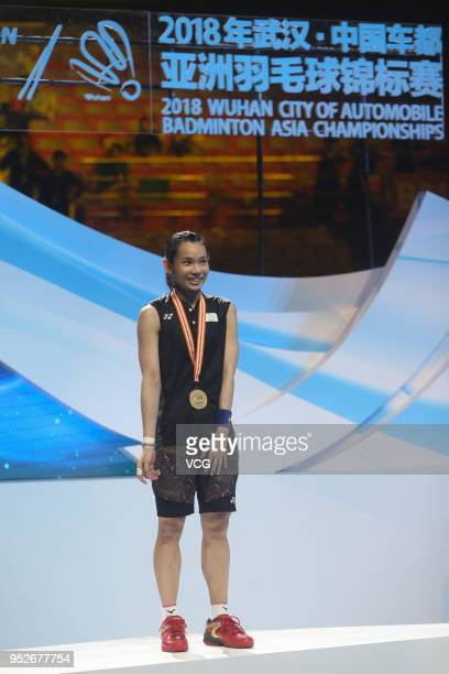 Tai Tzu Ying of Chinese Taipei poses with gold medal on the podium during women's singles final match on day six of 2018 Badminton Asia Championships...