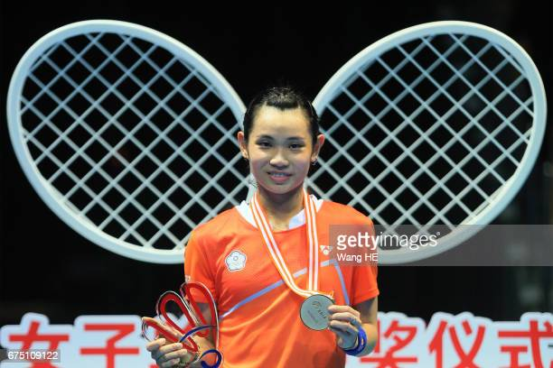 Tai Tzu Ying of Chinese Taipei poses with her gold medals on the podium after winning the women's singles against Akane Yamaguchi of Japan at the...