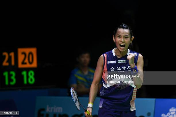 Tai Tzu Ying of Chinese Taipei reacts a point as she compete against He Bingjiao of China during the Women's Singles Semifinal match on day five of...