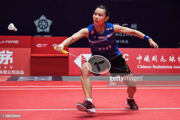 Tai Tzu Ying of Taiwan hits a return against Busanan Ongbamrungphan of Thailand during their women's singles third round match at the BWF World Tour...