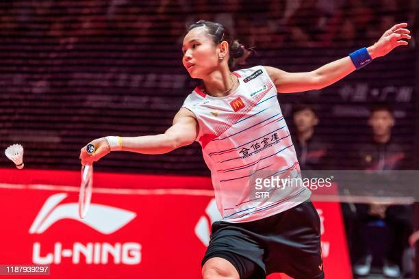 Tai Tzu Ying of Taiwan hits a return against Nozomi Okuhara of Japan during their women's singles first round match at the BWF World Tour Finals...