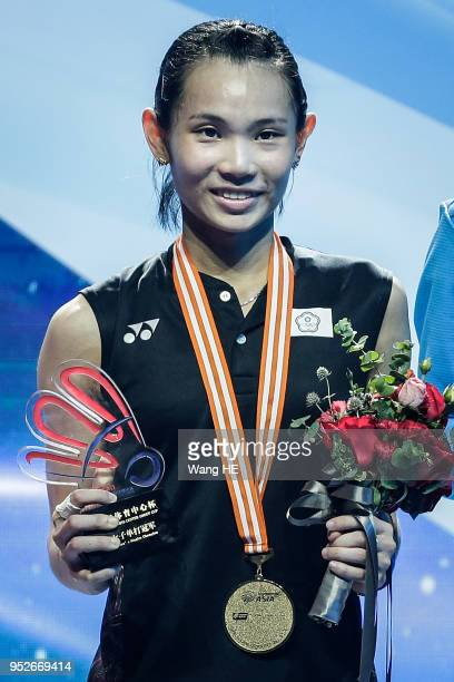 Tai Tzuying of Chinese Taipei pose gold medals on the podium after winning the women's singles final match against Chen Yufei of China at the 2018...