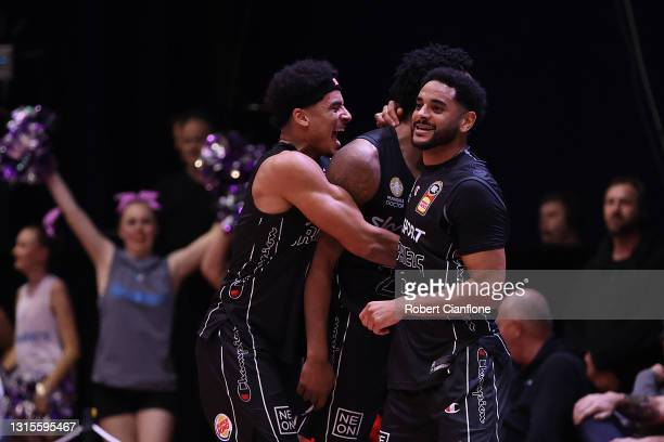 Tai Webster, Levi Randolph and Corey Webster of the Breakers celebrate their victory during the round 16 NBL match between the New Zealand Breakers...