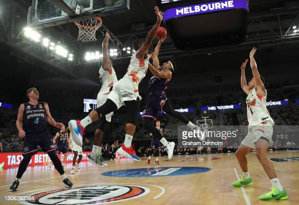 Tai Webster of the Breakers shoots under pressure during the NBL Cup match between the New Zealand Breakers and the Cairns Taipans at John Cain Arena...