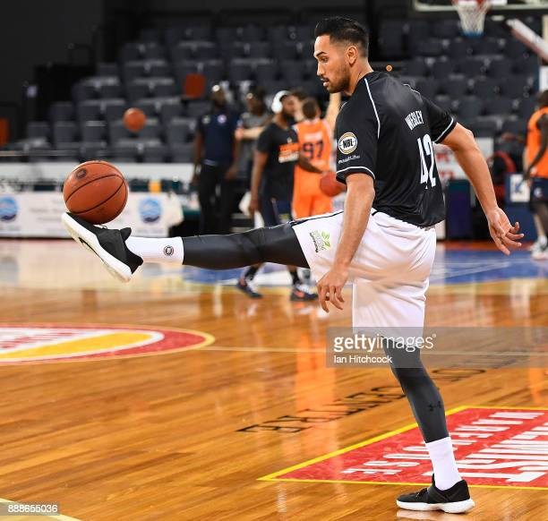 Tai Wesey of Melbourne United warms up before the start of the round nine NBL match between the Cairns Taipans and Melbourne United at Cairns...
