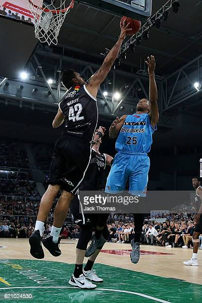 Tai Wesley of Melbourne United blocks Akil Mitchell of the Breakers shot during the round five NBL match between Melbourne United and the New Zealand...