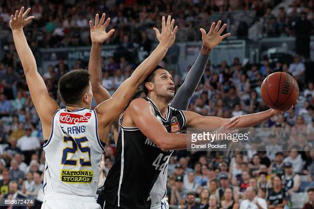 Tai Wesley of Melbourne United drives to the basketn under pressure during the round 12 NBL match between Melbourne United and the Brisbane Bullets...