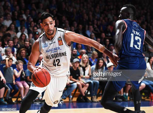 Tai Wesley of Melbourne United gets around Majok Deng of the Adelaide 36ers during game four of the NBL Grand Final series between the Adelaide 36ers...
