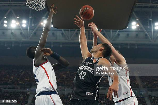 Tai Wesley of Melbourne United Majok Deng of the 36ers and Daniel Johnson of the 36ers contest the ball during game five of the NBL Grand Final...