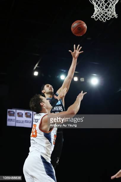 Tai Wesley of the Breakers puts up a shot over Alex Loughton of the Taipans during the round five NBL match between the New Zealand Breakers and the...
