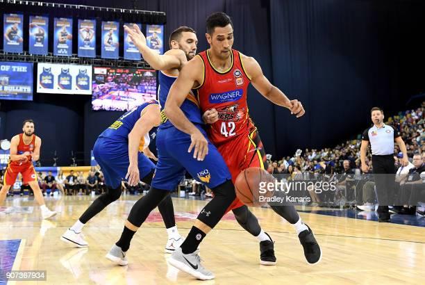 Tai Wesley of United takes on the defence of Adam Gibson of the Bullets during the round 15 NBL match between the Brisbane Bullets and Melbourne...