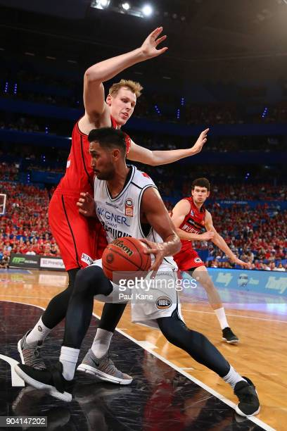 Tai Wesley of United works to the basket against Rhys Vague of the Wildcats during the round 14 NBL match between the Perth Wildcats and Melbourne...