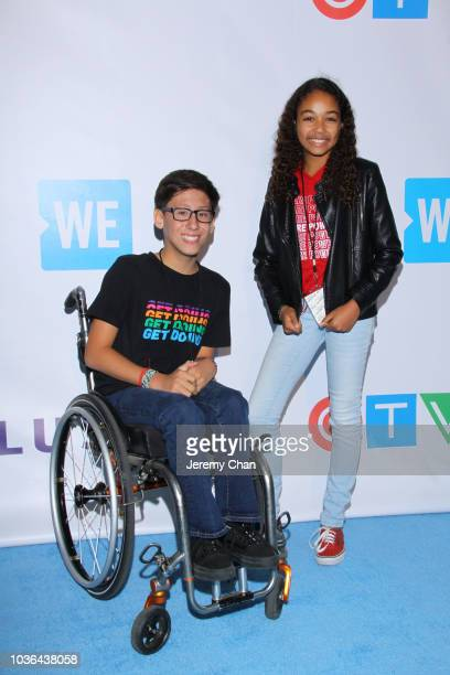 Tai Young and Millie Davis arrive to WE Day Toronto and the WE Carpet at Scotiabank Arena on September 20 2018 in Toronto Canada