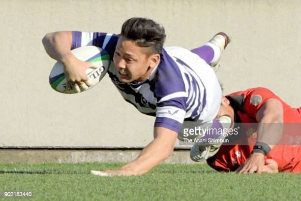 Taichi Takahashi of Meiji dives to score his side's second try during the 54th All Japan University Rugby Championship Final at Teikyo and Meiji at...