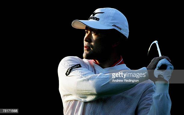 Taichi Teshima of Japan hits his second shot on the second hole during the first round of the Dubai Desert Classic on the Majilis Course at Emirates...