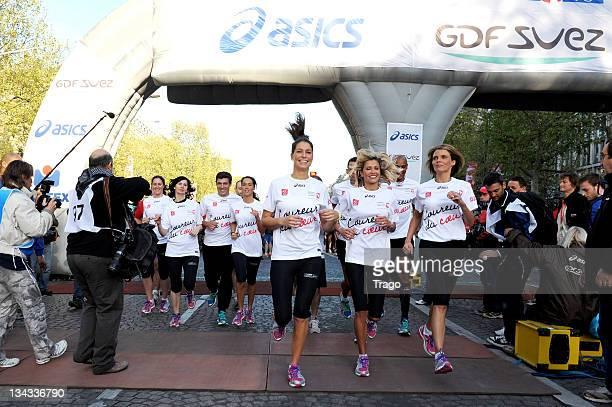 Taig Khris Louis Laforge Alexandra Rosenfeld Marc Raquil Sylvie Tellier Laury Thilleman Karine Lima and Laurence Fischer run the Paris Marathon 2011...