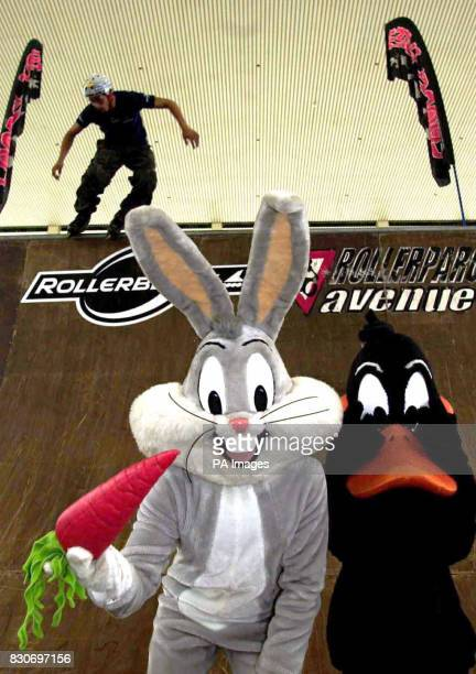 Taig Khris the number one Verts skater in the world shows off his tricks at the Looney Tunes skate village Milton Keynes watched by cartoon...