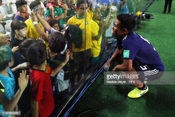 Taiga Hata of Japan takes a selfie with fans after the Group D Match between Japan and Netherlands in the FIF U17 World Cup Brazil 2019 on October 27...