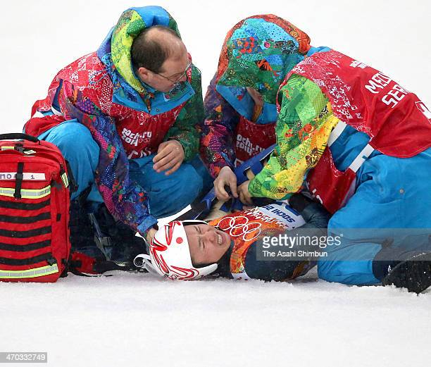 Taihei Kato of Japan crashes as he competes in the Nordic Combined Men's Individual LH on day 10 of the Sochi 2014 Winter Olympics at RusSki Gorki...