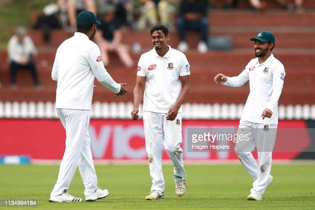 Taijul Islam of Bangladesh celebrates with Mominul Haque after taking the wicket of Kane Williamson of New Zealand during day four of the second test...