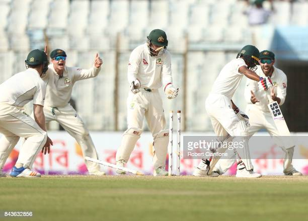 Taijul Islam of Bangladesh is bolwed by Nathan Lyon of Australia during day four of the Second Test match between Bangladesh and Australia at Zahur...