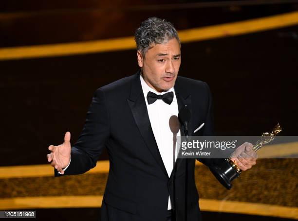 Taika Waititi accepts the Writing Adapted Screenplay award for 'Jojo Rabbit' onstage during the 92nd Annual Academy Awards at Dolby Theatre on...