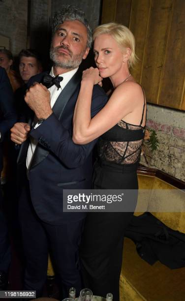 Taika Waititi and Charlize Theron pose the Netflix BAFTA after party at Chiltern Firehouse on February 2 2020 in London England