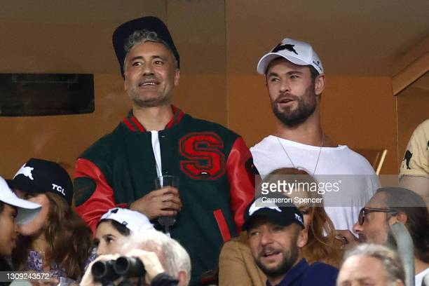 Taika Waititi and Chris Hemsworth watch the round three NRL match between the South Sydney Rabbitohs and the Sydney Roosters at Stadium Australia on...