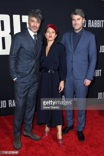 Taika Waititi Chelsea Winstanley and Carthew Neal attend the premiere of Fox Searchlights' Jojo Rabbit at Post 43 on October 15 2019 in Los Angeles...