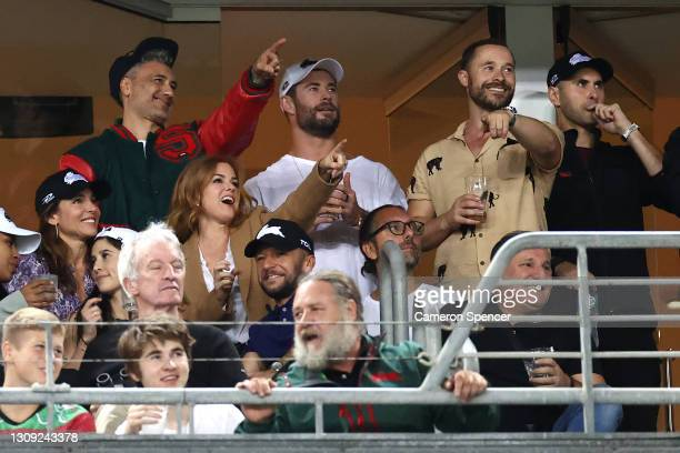 Taika Waititi, Chris Hemsworth, Elsa Pataky, Isla Fisher and Russell Crowe watch the round three NRL match between the South Sydney Rabbitohs and the...