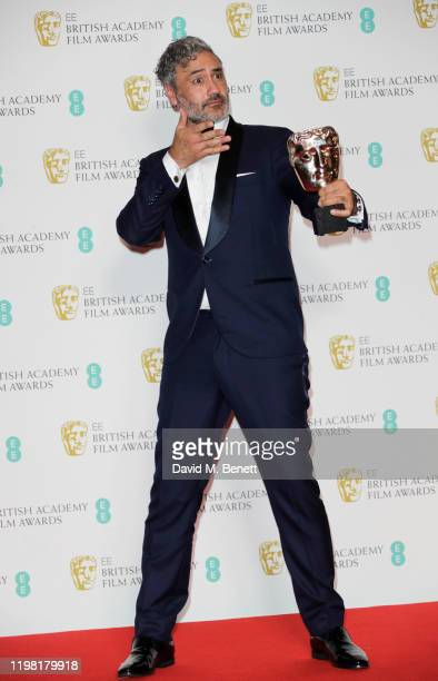 """Taika Waititi, winner of the Best Adapted Screenplay award for """"Jojo Rabbit"""", poses in the Winners Room at the EE British Academy Film Awards 2020 at..."""