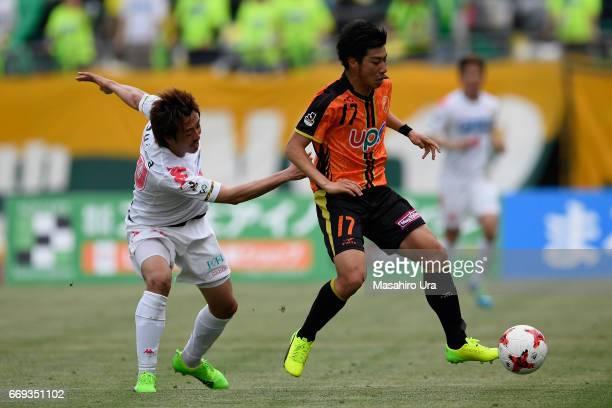 Taiki Kato of Renofa Yamaguchi controls the ball under pressure of Masashi Wakasa of JEF United Chiba during the JLeague J2 match between Renofa...