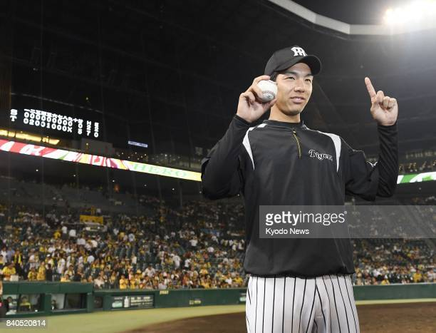Taiki Ono of the Hanshin Tigers poses after the rookie pitcher picked up his first win at Koshien Stadium in Hyogo Prefecture on Aug 29 2017 ==Kyodo